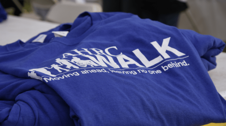 A picture of the AHRC Walk shirt that features the tagline,