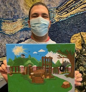 Richard Infante shows his painting of a park
