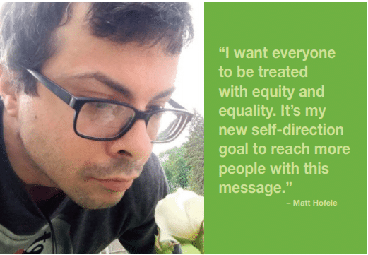 """Matt Hofele looks at flower and shares """"I want everyone to be treated with equity and equality. It's my new self-direction goal to reach more people with this message."""""""