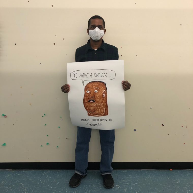 Artist shows his painting of MLK