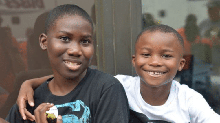 Two children from the AHRC Nassau community of family and friends enjoy a moment at an event.