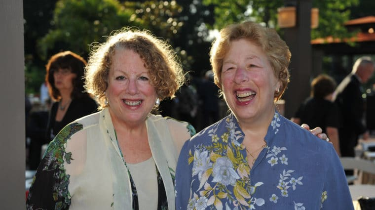 Sisters Roz and Shelley Goldmacher smile at an AHRC Nassau event.