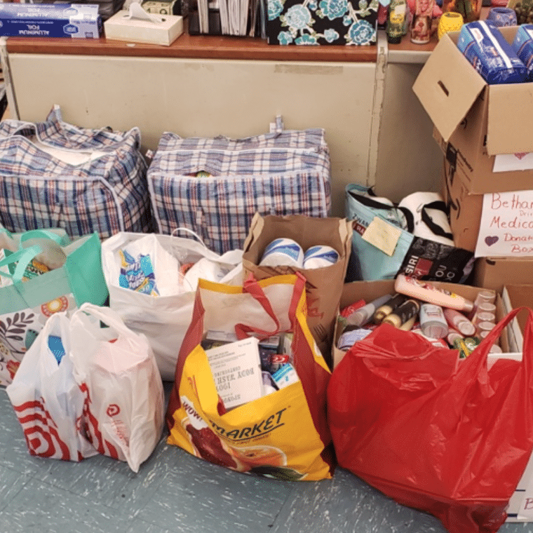 Bags of toothpaste, toothbrushes, toilet paper, shampoo and other donations for Bethany House