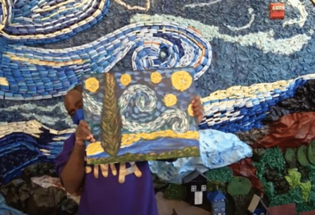 "Artist Douglas shows a piece from the ""Starry Night"" exhibit"