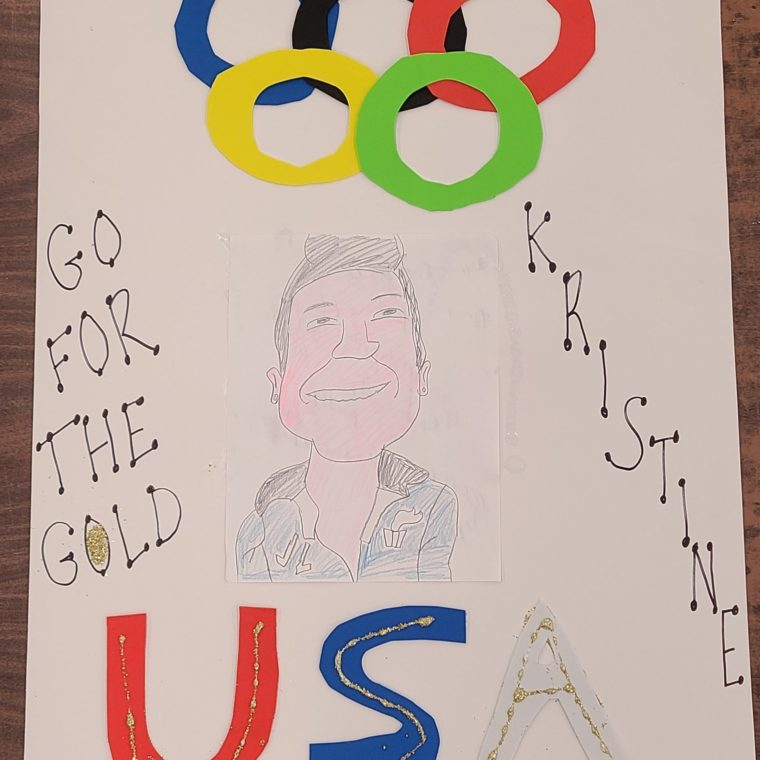 """Sign that says """"Go for the gold! USA - Kristine!"""""""