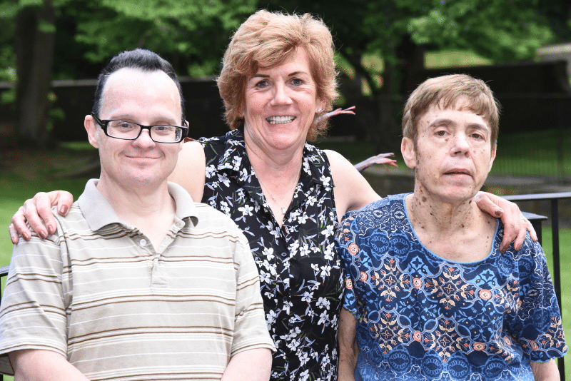 AHRC Nassau's Lynne Brewer helps her friend Billy Meyer have a lifetime of memories in 18 months. She is pictured standing with Billy and her sister, Diane.