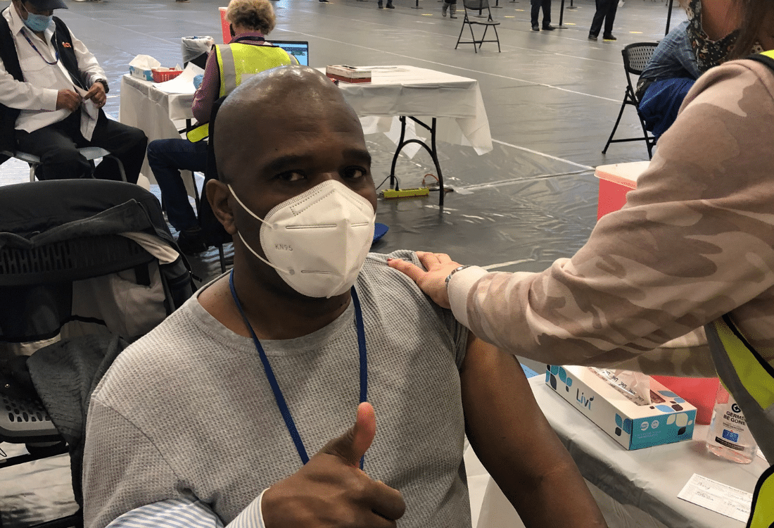 AHRC Nassau Executive Director Stanfort Perry receives vaccination.