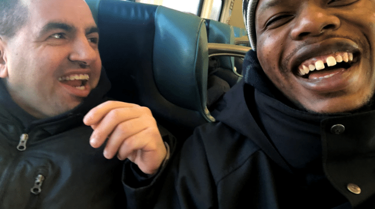 Derek Carney and Direct Support Professional Greg Sanniez laugh and enjoy their time on the Long Island Railroad.