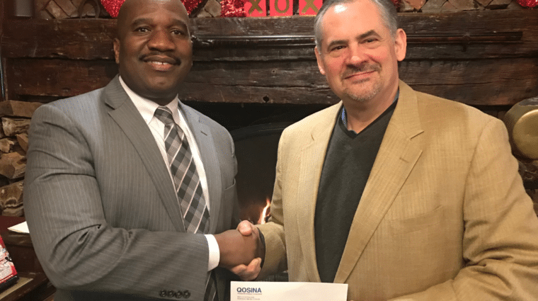 Ken Wolcott, director of marketing and product development for Qosina, recently made a $5,000 donation, accepted by Stanfort J. Perry, executive director of AHRC Nassau.
