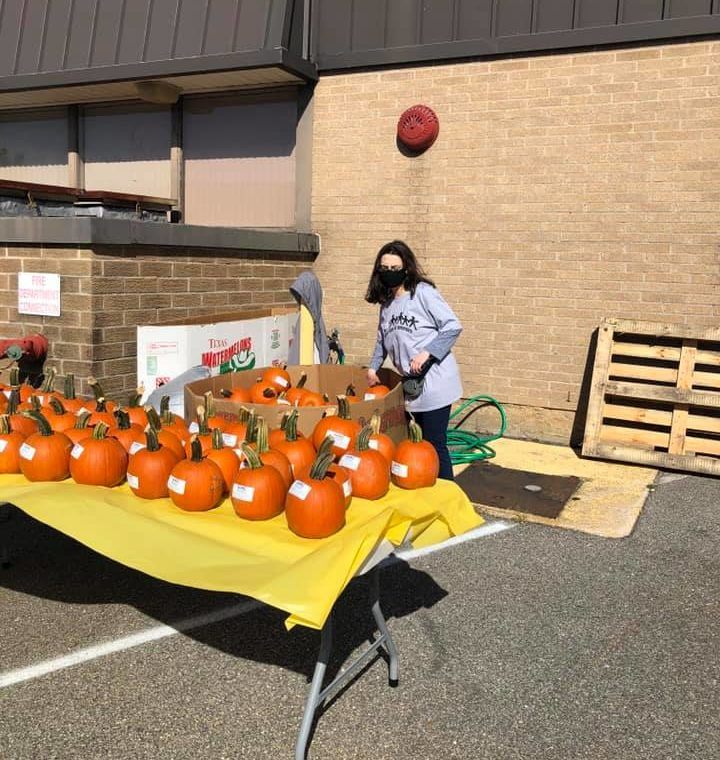 Volunteer Helps With Table at Staff Appreciation Day