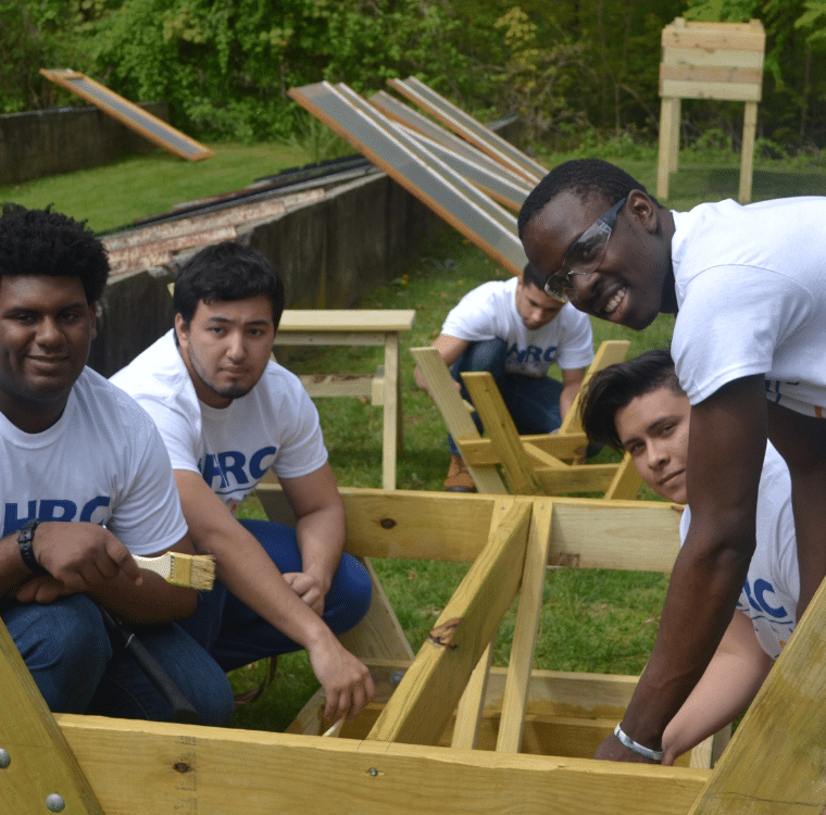 AHRC Nassau and BOCES - Barry Tech add finish to a picnic table.