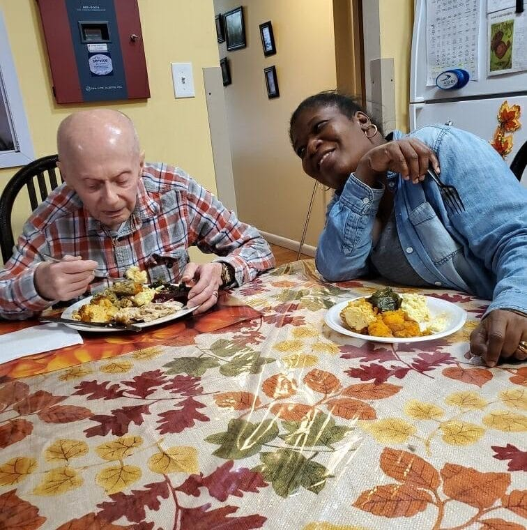 Person supported by AHRC enjoys Thanksgiving dinner