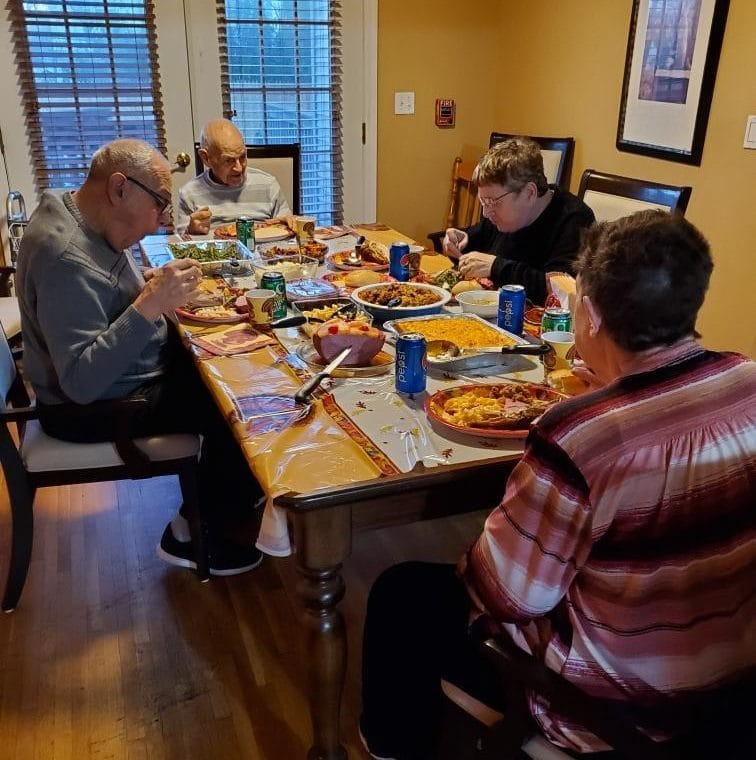 People supported by AHRC sit down to Thanksgiving dinner