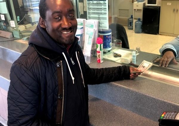 Vladimir Noel pays for Long Island Railroad tickets.