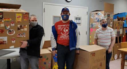 People supported by AHRC Day Services gather donations for neighbors